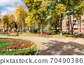 In the courtyard of stalinka building. Orange and green trees, Ukraine, Kharkov 70490386