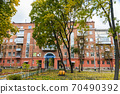 In the courtyard of stalinka building. Orange and green trees, Ukraine, Kharkov 70490392