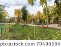 In the courtyard of stalinka building. Orange and green trees, Ukraine, Kharkov 70490394
