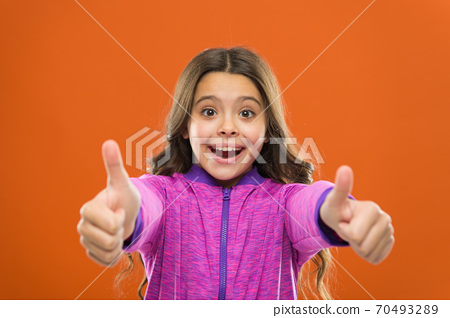 Kids actually like concept. Kid show thumb up. Girl happy  70493289
