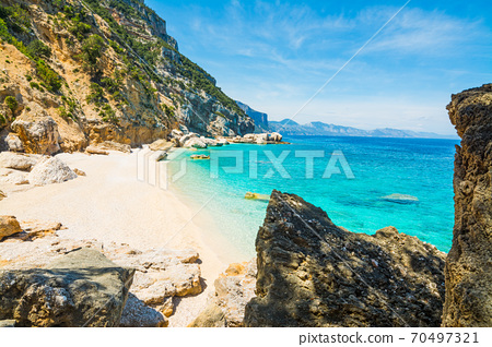 Rocks and sand in Cala Mariolu 70497321