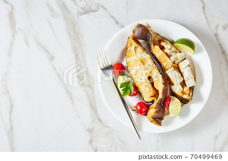 Smoked halibut steaks on a marble background 70499469