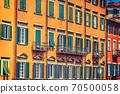 Colorful facades in Pisa Lungarno 70500058