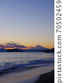 View of Enoshima and Mt. Fuji in the evening view from Inamuragasaki 70502459