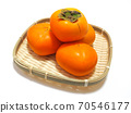 Persimmons in a basket Persimmons in a bamboo colander 70546177