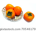 Persimmons in a basket Persimmons in a bamboo colander 70546179