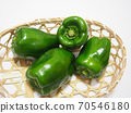 Peppers in a basket Peppers in a bamboo colander 70546180