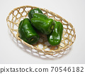 Peppers in a basket Peppers in a bamboo colander 70546182