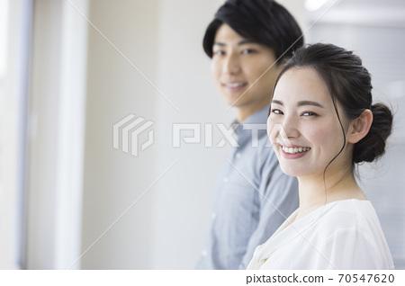 Smiley men and women office 70547620