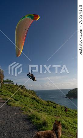 Paraglider extreme sports in summer day phuket thailand. 70554128