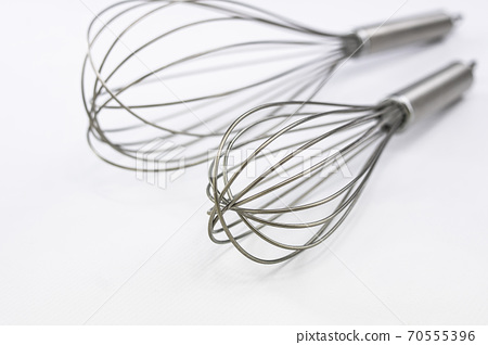 Sticks to beat, mix and stir in a kitchen when making a recipe. Cooking utensil. 70555396