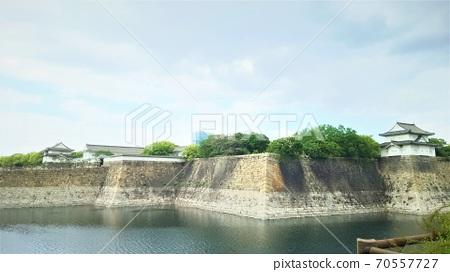 Ishigaki and moat surrounding the castle 70557727