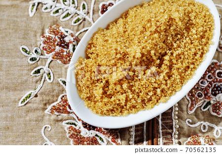 Brown sugar in white bowl 70562135