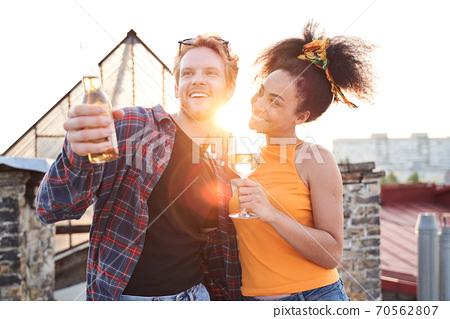 Happy couple spending romantic evening on roof 70562807