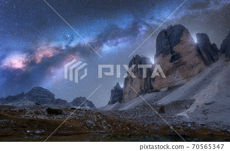 Milky Way over mountains at night in summer. Tre Cime 70565347