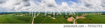 Panorama of Many windmills on the vast grassland with mountains and sky as a background in Thailand. 70582701