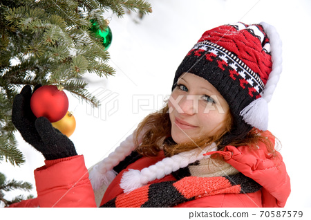 attractive girl with Christmas tree 70587579