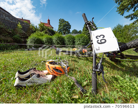 Triathlon race base camp with racers equipment. 70596613