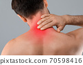 Closeup of man touching his inflammated neck 70598416