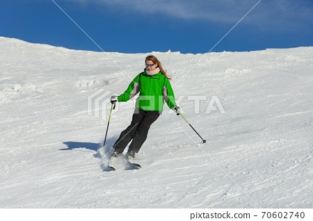 Skiing in the winter snowy slopes 70602740