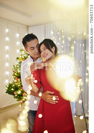 Dancing among Christmas lights 70603713