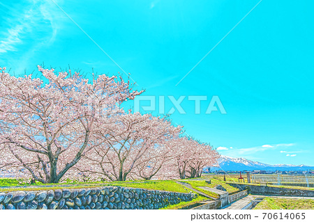 [Anime style] Spring in Japan Rural scenery seen from the Funagawa embankment in Toyama prefecture 70614065