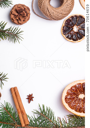 Christmas composition with dried citrus slices, cinnamon, anise, pine cones and fir tree branches, top view copy space 70614659