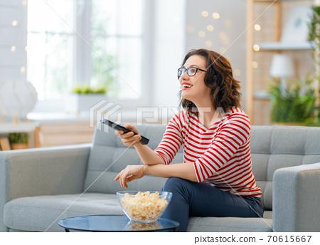 Young woman watching  TV 70615667