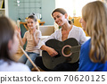 Group of homeschooling children with teacher having music lesson indoors, coronavirus concept. 70620125