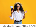 Cheerful Young Woman In Summer Hat And Eyeglasses Holding Passport And Tickets 70623220