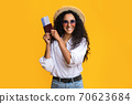 Young Traveller Woman Posing With Passport And Tickets Over Yellow Background 70623684