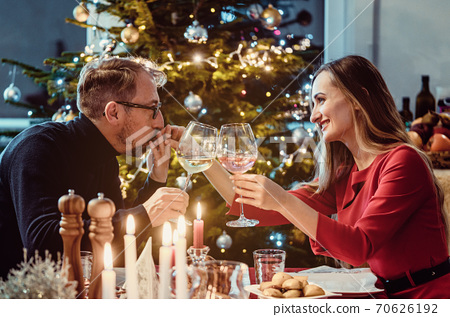 Middle aged couple drinking wine on Christmas eve 70626192