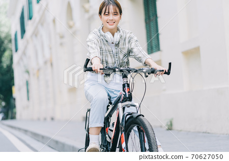 woman cycling on the street 70627050