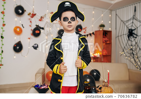 Boy in pirate skeleton costume 70636782