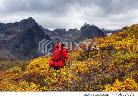 Woman Backpacking on Scenic Rocky Hiking Trail 70637678