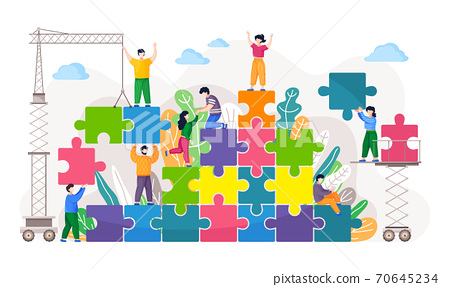 Business concept of coworking. Coworkers assembling jigsaw puzzle. Team building metaphor 70645234