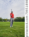 Professional player aiming his clubface at the target 70651898