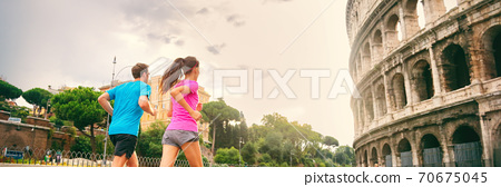 Runners running next to colosseum in Rome city, Italy, Europe travel destination. Healthy active people lifestyle. Banner panorama crop 70675045