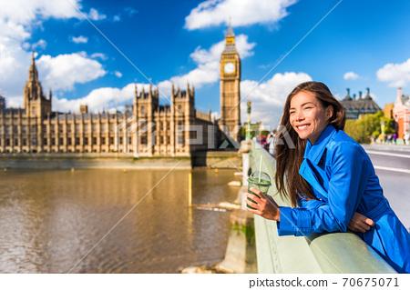 London Big Ben tourist woman drinking green detox smoothie. Healthy businesswoman on Westminster Bridge with Big Ben background, London Europe destination, England, Great Britain 70675071