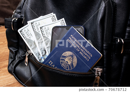 Passport and dollars in the bag closeup 70678712