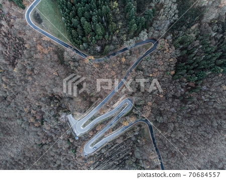 Seasons Concept winter or fall Aerial view Winding road serpentine mountain pass village Brodenbach Germany 70684557