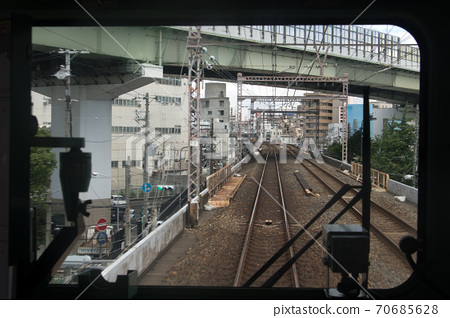 The train ride on the track of the railway corridor in Japan.  70685628