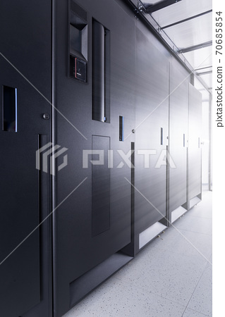 row of server cabinets inside data center room 70685854
