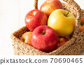 A full basket of freshly picked apples! White background 70690465