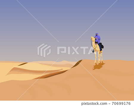 A camel rider in the desert has a sky background. 70699176