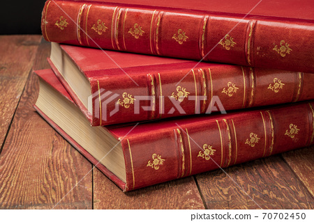antique books with red leather spin 70702450