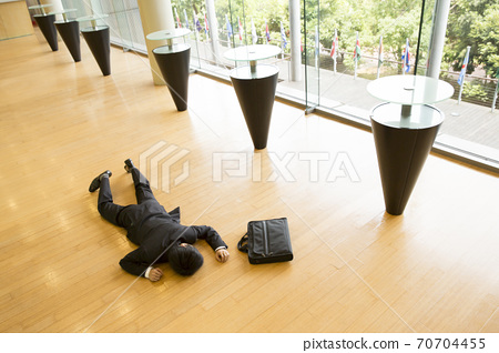 A collapsing businessman 70704455