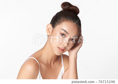 Beautiful young asian woman with clean fresh skin on white background, Face care, Facial treatment, 70715296