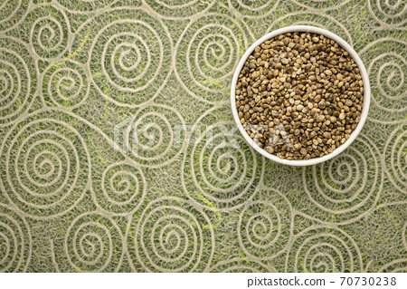 hemp seeds in a ceramic bowl 70730238