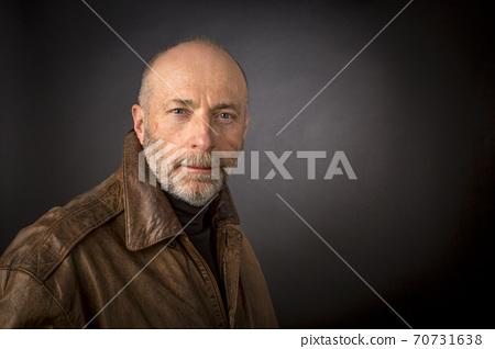 headshot of older man in leather jacket 70731638